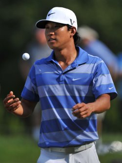 Anthony Kim tosses his golf ball during the TPC Players in Florida