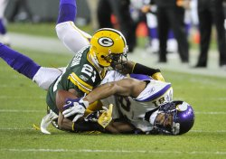 Packers Woodson breaks up pass intended for Vikings Shiancoe in Green Bay, Wisconsin