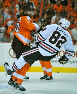 Flyers Scott Hartnell body checks Blackhawks' Tomas Kopecky during the 2010 Stanley Cup Final