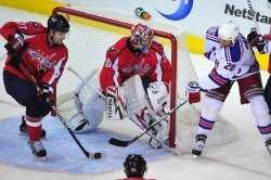 Washington Capitals defenseman Karl Alzner stops a shot from New York Rangers Vinny Prospal in Washington