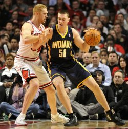 Pacers Hansbrough posts on Bulls Scalabrine in Chicago