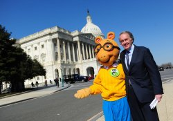Rep. Edward Markey (D-MA) poses with Arthur the Ant in Washington