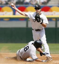 Chicago White Sox second baseman Chris Getz turns a double play against the New York Yankees