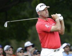 Lee Westwood of England hits a tee shot at the PGA