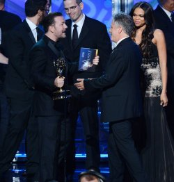 Jon Stewart and Ricky Gervais attend the 64th Primetime Emmy Awards in Los Angeles