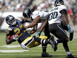 Jacksonville Jaguars Rashean Mathis forces New York Jets Shonn Greene to the ground at MetLife Stadium in New Jersey