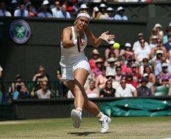 Sabine Lisicki returns against Marion Bartoli in the Wimbledon Women's Final 2013 match