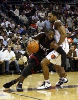 Miami Heat guard Dwyane Wade against Charlotte Bobcats guard Gerald Henderson