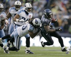 Tennessee Titans safety Michael Griffin tackles Seattle Seahawks Julian Jones .