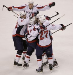 Capitals celebrate first period goal against Bruins at TD Garden in Boston, MA.