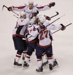 Capitals celebrate first period goal against Bruins at TD Garden in Boston, MA.