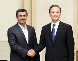 Ahmadinejad and Wen shake hands in Beijing