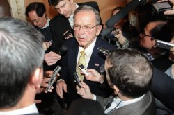 Sen. Ted Stevens talks to reporters in Washington