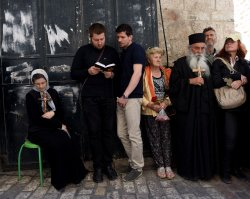 Orthodox Christians Pray With Crosses On Good Friday, Jerusalem