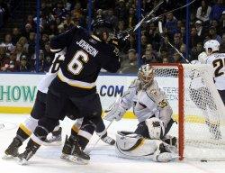 Predators goalie Pekka Rinne blocks a shot in St. Louis