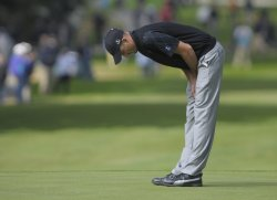 Geoff Ogilvy reacts after missing a putt during the first round of the 2009 Presidents Cup in San Francisco