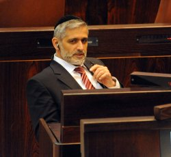 Israeli Interior Minister Eli Yishai of the Ultra-Orthodox Shas Party, attends a session of the Knesset, the Israeli Parliament, in Jerusalem