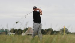 Darren Clarke plays out of the rough during the Open Championship in England.