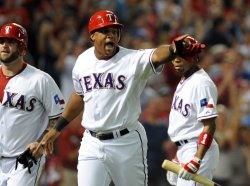 Rangers Beltre scores on a Murphy hit a two-run single in game six of the ALCS in Texas