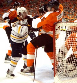 Buffalo's Nathan Gerbe shoves Flyers Matt Carle during second period in Philadelphia.