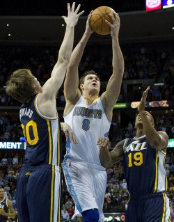 Nuggets Gallinari Drives Against the Jazz in Denver