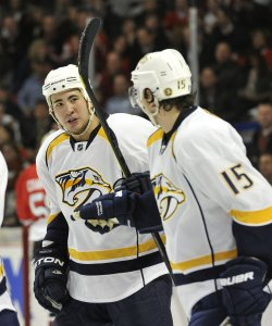 Predators Yip congratultes Smith against Blackhawks in Chicago
