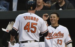 Orioles' Mark Trumbo is congratulated after his solo home run against the Yankees
