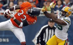Chicago Bears' Charles Tillman intercepts a pass in Chicago