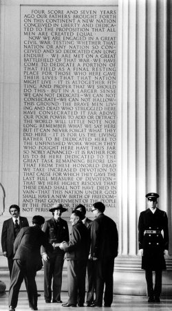 Deng Xiaoping standing in front of Gettysburg Address at the Lincoln Memorial.