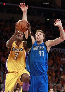 Dallas Mavericks' Dirk Nowitzki defends Los Angeles Lakers' Lamar Odomin the second half of Game 1 of the Western Conference semifinals in Los Angeles.