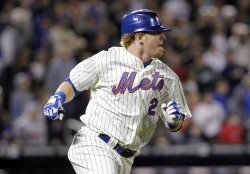 New York Mets Justin Turner runs to first base at Citi Field in New York