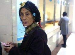 A Tibetan woman picks up her prescription at a Tibetan hospital in Ganzi Prefecture