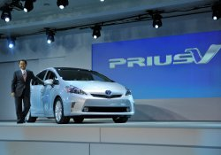 Toyoda stands with Prius Vat the 2011 NAIAS in Detroit