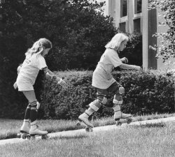 Amy Carter and friend rollerskate outside the White House