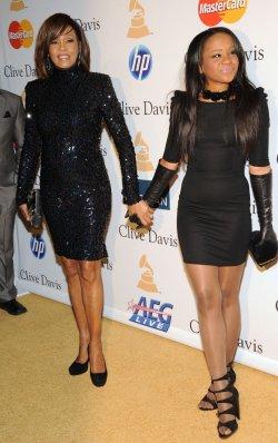 Whitney Houston and Bobbi Kristina Brown arrive at pre-Grammy gala honoring David Geffen in Beverly Hills, California