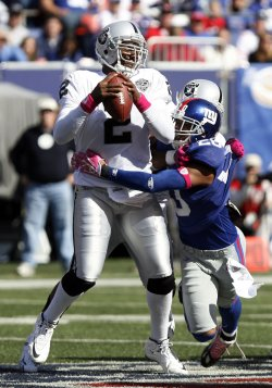 Oakland Raiders quarterback JaMarcus Russell is sacked by New York Giants Michael Johnson for a loss of 6 yards un the second quarter in week 5 of the NFL season at Giants Stadium in New Jersey
