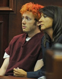 James Holmes Charged with 24 Murders in Colorado