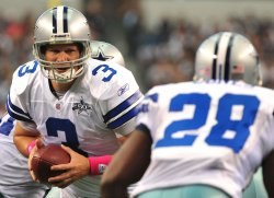 Cowboys' quarterback Jon Kitna hands off to running back Felix Jones in Texas