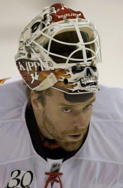 Flames Goalie Kiprusoff Skates to the Bench in Denver