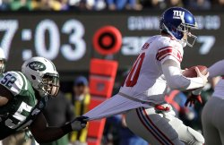 New York Jets David Harris grabs the jersey of New York Giants Eli Manning and sacks him for a 5 yard loss at MetLife Stadium in New Jersey