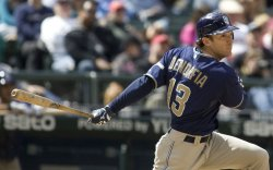 San Diego Padres' Chris Denorfia watches his two-run RBI double against the Seattle Mariners in Seattle