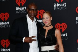 Eric Dickerson and Penny Sutton arrive for the iHeartRadio Music Festival
