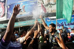 Palestinians Celebrate After Presidential Candidate Mohamed Morsi's Victory.
