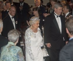 Queen Elizabeth and Prince Philip attend a Government of Canada dinner in Toronto on their Royal Tour