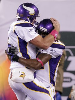 Minnesota Vikings quarterback Brett Favre reacts with Randy Moss after throwing his 500th career touchdown pass at New Meadowlands Stadium in New Jersey