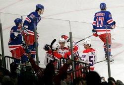 Washington Capitals Nicklas Backstrom, Alexander Semin and Roman Hamrlik react at Madison Square Garden in New York