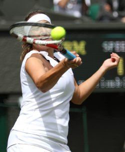 Aravane Rezai returns at Wimbledon.