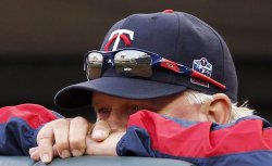 Twins manager Gardenhire watches against Red Sox in Minneapolis