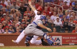 St. Louis Cardinals Randal Grichuk tagged out at home