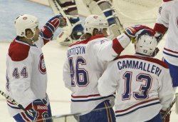 Canadiens Hamrlik and Kostitsyn Congratulate Teammate Cammalleri after Goal Against the Avalanche in Denver